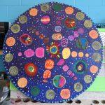 Le cycle de l'Univers - École Jean-Nicolet, Montréal-Nord, Élèves du 2e cycle du primaire, Monotype et gravure sur polystyrène sur papier, marouflé sur bois, 122x 122 cm